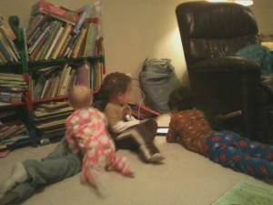iPad ftw - ironically in a pile watching the EXACT same thing they could be viewing on the big tv just out of frame.